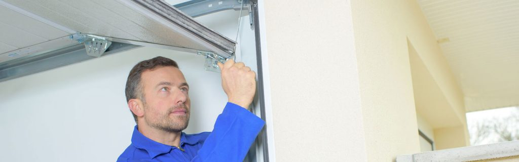 Garage Door Repairmen Working on a New Door Install in Brooklyn Park