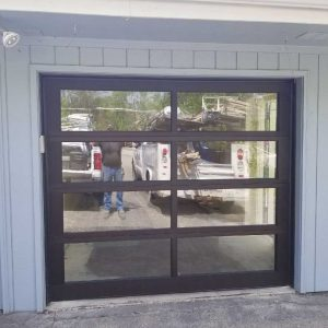Garage door after being repaired and refreshed by Garage Doors Plus, LLC